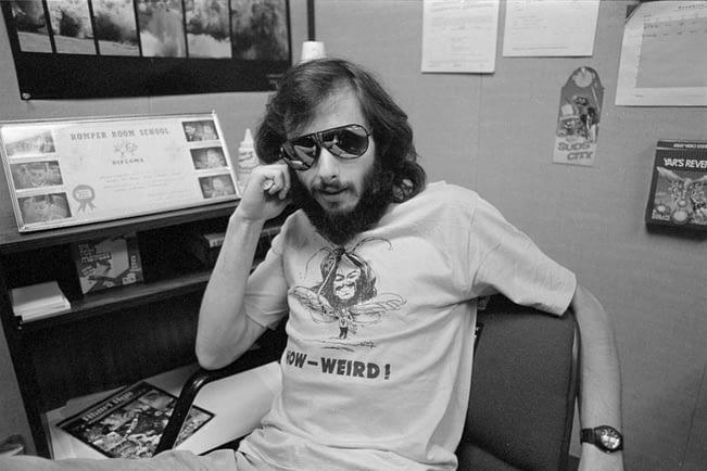Howard Scott Warshaw in weird t-shirt, sitting at desk